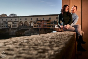 Seated and lit couple engagement image from Florence