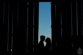 Silhouette of a newly engaged couple in barn at a farm