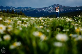 Mountains and Fields couple engagement picture session in Vail, CO in the mountain top flowers