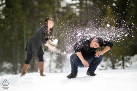 Winter mountain couple engagement portraits of a snowball fight at Lake Tahoe, Nevada