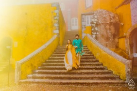 Bright sunlight couple engagement image from the Pena Palace in Sintra, Portugal