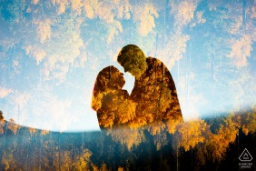 Artistic fall couple engagement portraits at Summit County, Colorado surrounded by golden aspen leaves