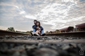 Train tracks couple engagement picture session of lovers on the rails in BORDEAUX, FRANCE
