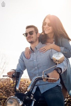 Motorcycle engagement photography of a nice young couple and their motorbike in Albi, France