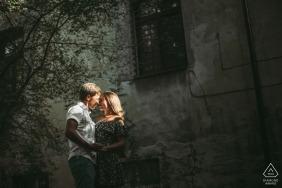 Urban light engagement image from Odessa, Ukraine of a couple posing on a street under harsh light