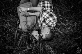 Relaxed engagement photography at Sky Meadows, Virginia of couple laying in a field