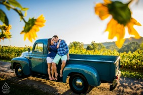 Rural and vintage engagement image from Westminster, Maryland with sunflowers and a blue truck