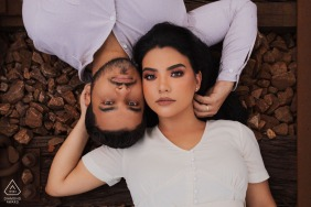 A Congonhas MG Couple lying on the train line for their overhead engagement portrait session