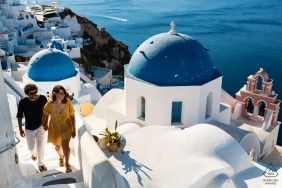 Santorini Couple climbing stairs above the water for their pre-wedding photoshoot