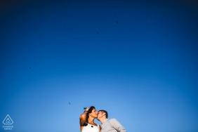 Pre-Wedding photo at Le Crete Senesi, Tuscany under a big, bright, blue sky
