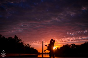 The groom-to-be lifts his fiance in front of the Washington Monument during a splendid sunrise in Washington DC