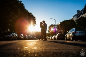 San Francisco engagement session of couple in the middle of a city street with a sunflare