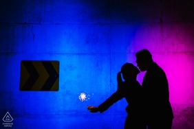 Washington DC engagement photo shoot at the colorful Kennedy Center, DC with a romantic, sparkler Kiss