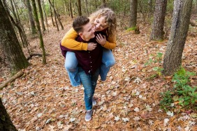 GA engagement photoshoot & pre-wedding session at Smithgall Woods, Helen, GA of a Piggyback ride