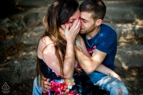 Paris engagement photoshoot & pre-wedding session at Parc de Vincennes - She is crying because their wedding was postponed to 2021, he is comforting her