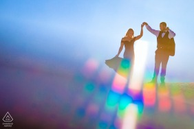 Creative The White Sands National Monument pre wedding and engagement photography in colorful sunlight