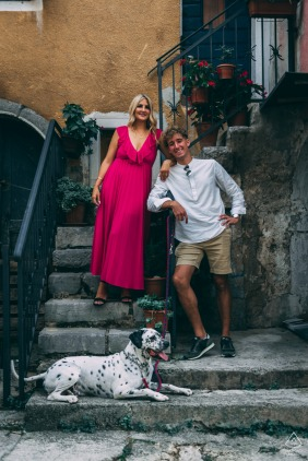 Slovenia pre wedding and engagement photography of a couple on stairs with a dog in Volosko, Croatia, their Best friend