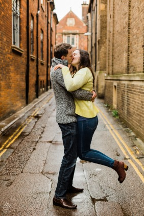 United Kingdom engagement photoshoot & pre-wedding session in Cambridgewith a kiss in the back streets