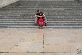 France engagement photo shoot on concrete stairs with a Couple in Paris