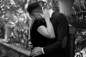 Andalusia engagement photo shoot with a formal couple hugging in Granada, Spain