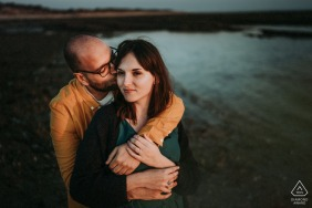 France pre wedding portrait session with engaged lovers embracing over Island of Re - A Young Couple hugging
