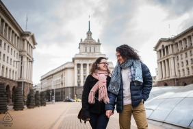BG pre wedding and engagement photography in Sofia, Bulgaria of a couple walking the city streets