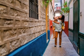 Spanish pre wedding portrait session with engaged lovers walking piggy back in Jaén, Spain