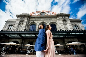 CO engagement portrait with a couple posed for a dramatic portrait in front of Denver's most recognizable building, Union Station