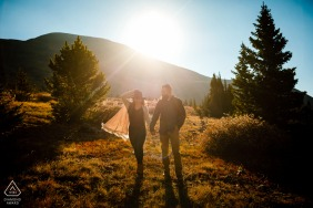 Colorado pre-wedding photo session with an engaged couple walking in the fields in Breckenridge, CO