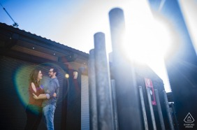 AZ engagement photoshoot & pre-wedding session in Downtown Phoenix with a couple and a sun flare