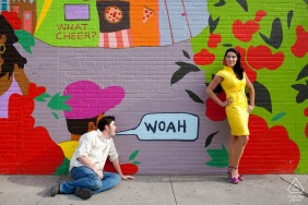 RI pre wedding and engagement photography of a couple in front of mural  in Providence, Rhode Island