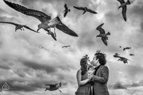 Turkey engagement portrait with a posed couple kissing under the birds in flight above Istanbul, Sultanahmet
