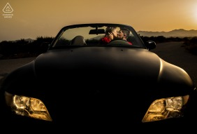 ES pre-wedding photo session with an engaged couple at sunset in Almeria - Spain with a Car and love