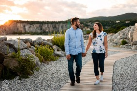 IT engagement photoshoot & pre-wedding session from Portopiccolo, Trieste, Italy showing the lovers Sunset walking on the boardwalk