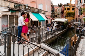 IT pre wedding and engagement photography showing a couple hanging out in Venice, Italy Over the canal