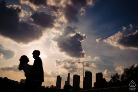 Vietnam pre wedding and engagement photography with Ho Chi Minh City behind the couple