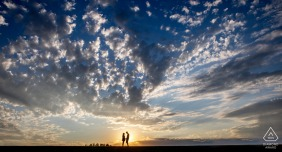 North Dakota engagement photoshoot & pre-wedding session from Fargo as the couple enjoys the sunset together