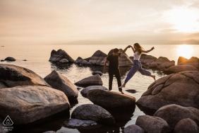 Nevada pre wedding and engagement photography at Hidden Beach: Lake Tahoe, NV of a Woman jumping from rock to rock in a large lake at sunset