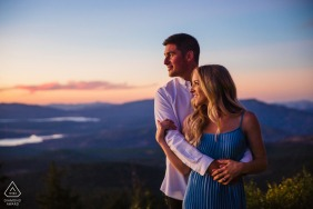 California wedding photographer in Truckee, CA with a couple embracing while watching the sunset on top of a mountain