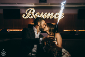 Bounce Bar, Chicago engagement portrait of couple with a sparkler lit bottle