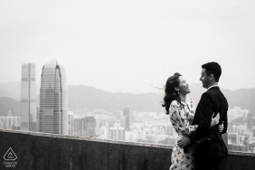 Barker Road, Victoria Peak, Hong Kong Black and white couple portrait in the background, the ICC and the IFC (the two tallest skyscrapers of Hong Kong) at the left hand side, form a juxtaposition of the couple