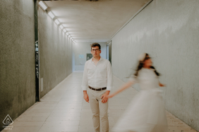 Belém, Lisboa, Portugal Couple dancing in a tunnel during an indoor engagement photo session