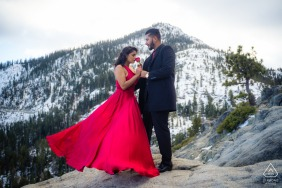 Emerald Bay, California couple Enjoying the roses on a windy mountaintop where they got engaged