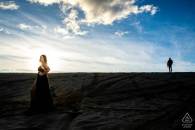 Kevin Sawyer wedding photography of couple under clouds