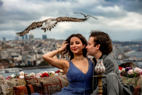 Suleymaniye, Istanbul, Turkey engagement shooting with a bird, wind, and a view of the city