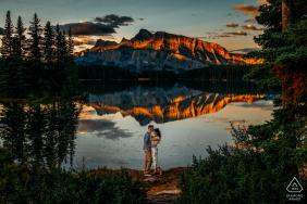 Two Jacks Lake, AB, CanadaSunrise engagement photo shoot with beautiful mountain reflections on the water