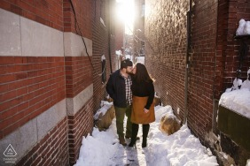 South End, Boston, Massachusetts mini urban pic shoot before the wedding day of a couple in an alley with fresh snow and setting sun