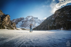 Lake Braies, Italy micro outdoor mountain photo session before the wedding day of a couple in the snowy mountains
