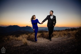 Big Bend National Park micro outdoor mountain photo session before the wedding day with a couple holding hands under a light