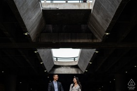 Los Angeles, California Urban Engagement Session in a concrete parking garage with skylights